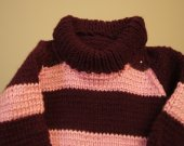 This sweater is a girls sweater it is in burgandy and pink,