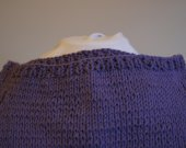 This tank top is a ladys size small in purple cotton,