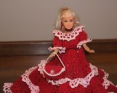 This doll is done in crochet and is The Holiday Gala collector costumes,