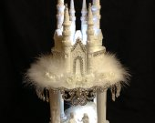 Wedding cinderella castle  carriage. with  couple of princes cake  topper  with illuminated  separator