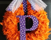 Orange burlap wreath with purple initial