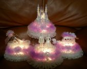 4 pc.cinderella castle  slipper  carriage  and wedding couple  light cake topper in lavender