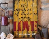 The greatest of these is LOVE, rustic, distressed wooden sign